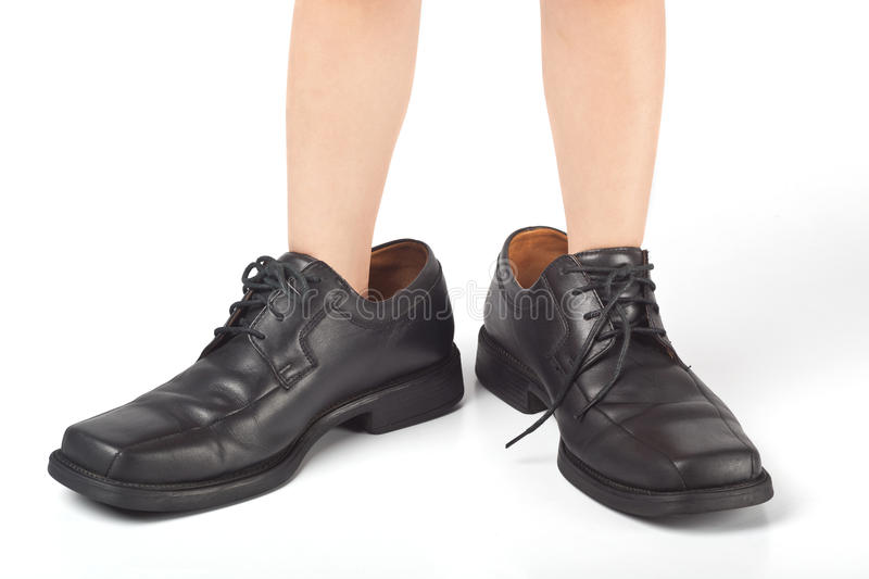Big shoes to fill royalty free stock photography