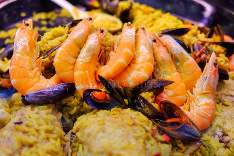 Big shrimps on paella sold on local market royalty free stock photo