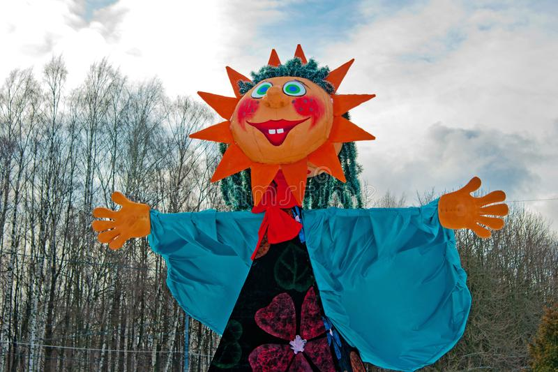 Big Shrovetide doll with face-sun for the burning at Russian national festival `Shrove` in Izmailovsky Park in Moscow stock photo
