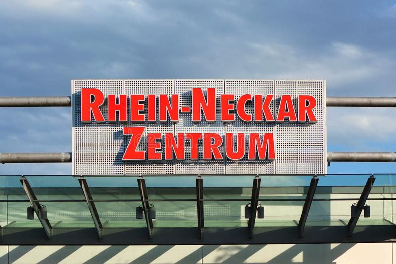 Big sign above entrance of shopping mall called `Rhein Neckar Zentrum` in front of blue sky stock images