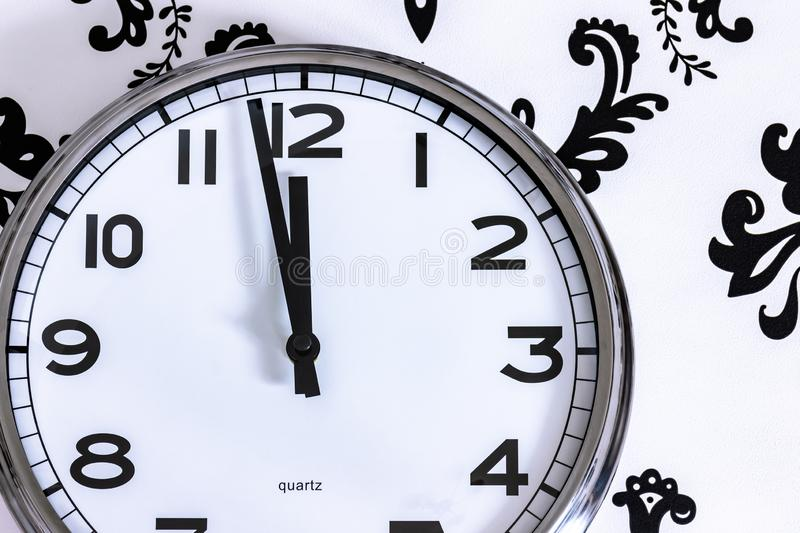 Big clock on the wall showing at almost midnight. royalty free stock photos