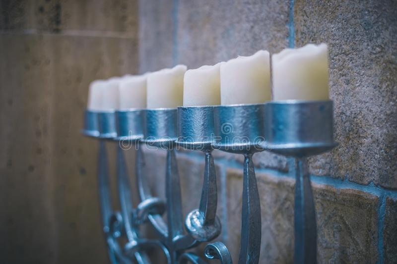 Big silver menorah with candles perspective view in synagogue stock images