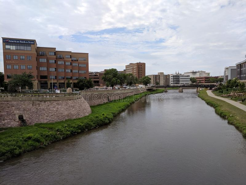Big Sioux River in Dowtown Sioux Falls. The Big Sioux River winds through downtown on its way to the falls. A bike trail follows the river greenway. Sioux Falls stock photography