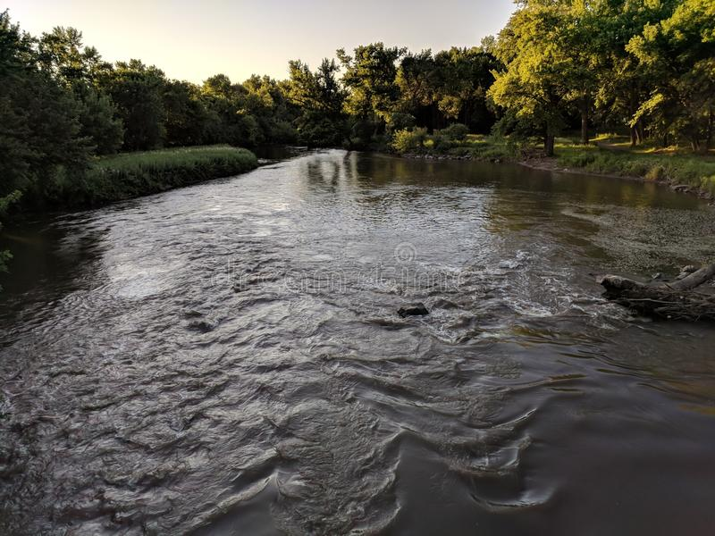 The Big Sioux River in Sioux Falls, South Dakota. The Big Sioux River, as seen from the footbridge between Tuthill Park and Paisley Park royalty free stock photos