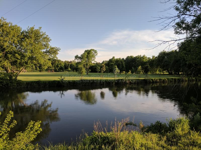 Big Sioux at Tuthill Park. The Big Sioux River almost encircles the town of Sioux Falls and became the basis for the park trail system stock image