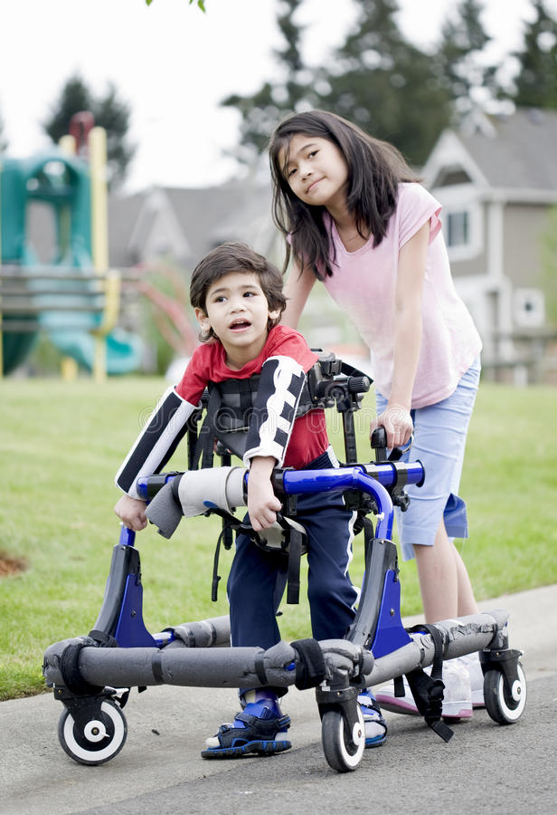 Download Big Sister Helping Disabled Brother Walk Stock Image - Image: 19981011