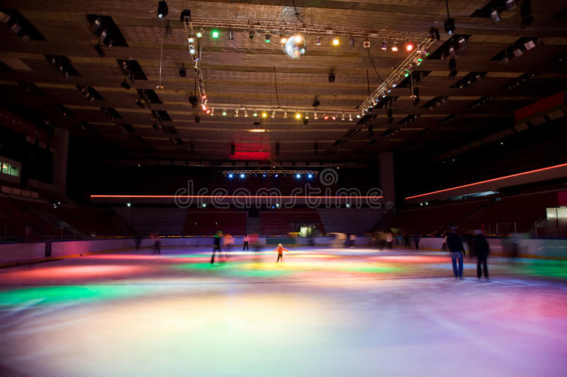 Big skating rink with multi-coloured illumination. Big covered skating rink with multi-coloured illumination in sports complex royalty free stock photography