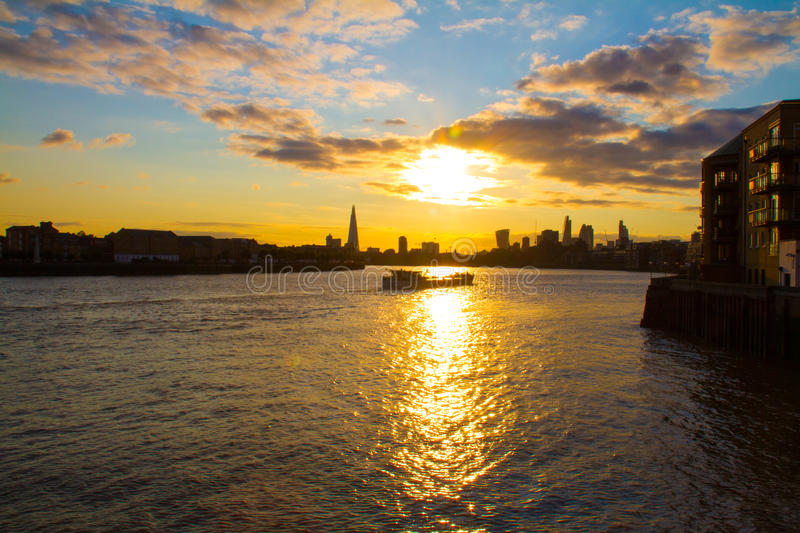 Big sky and a barge boat on Thames River, London royalty free stock photo