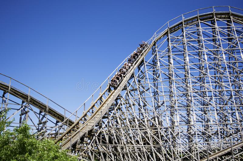 Big slope on a ride of a giant roller coaster royalty free stock photography