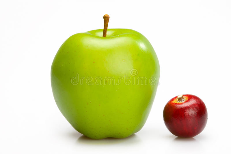 Big and small apples. royalty free stock photography
