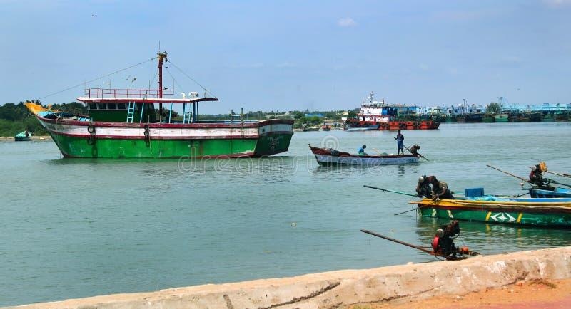 Big and small boats on the karaikal beach. royalty free stock image