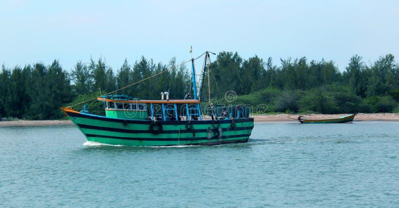 Big and small boats sail in the karaikal beach. royalty free stock images
