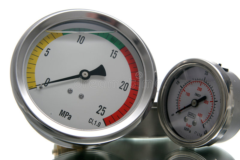 Big and small manometer. With hand and color scale royalty free stock photos