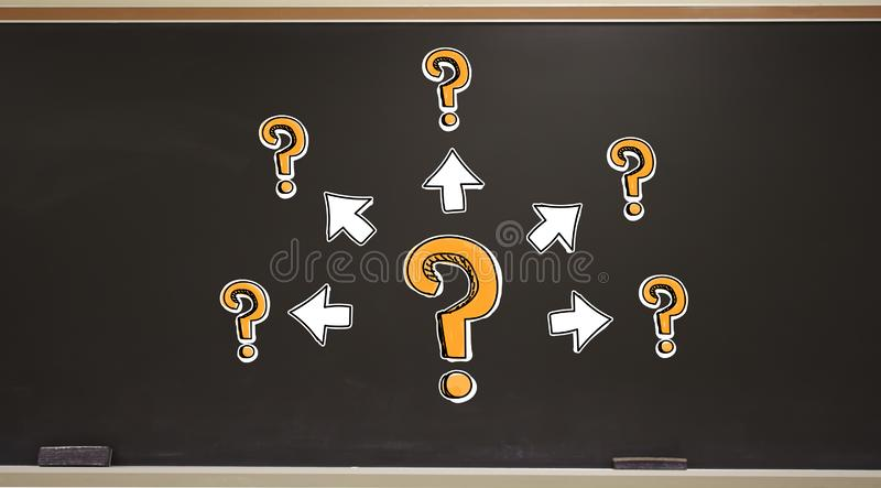 Big and small question marks with arrows on a blackboard stock photo