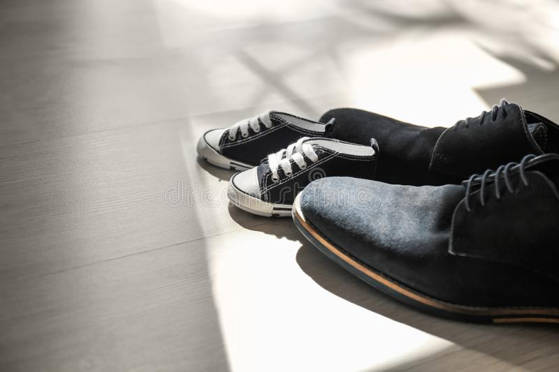 Big and small shoes on floor. Father's day celebration royalty free stock photography