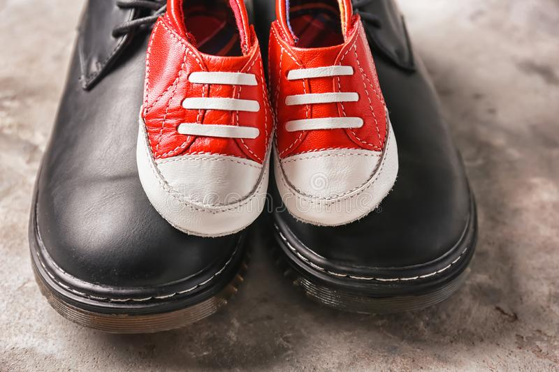 Big and small shoes on grey background. Father's day celebration stock photos