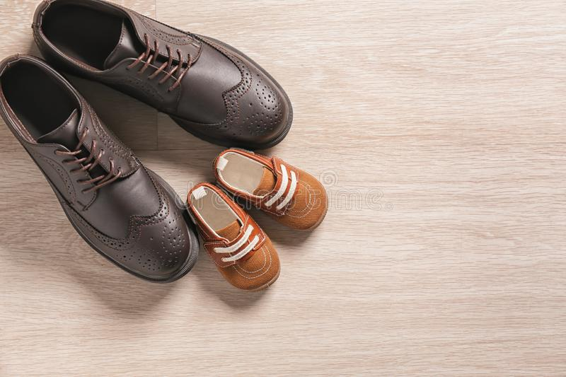 Big and small shoes on light background. Father's day stock photography
