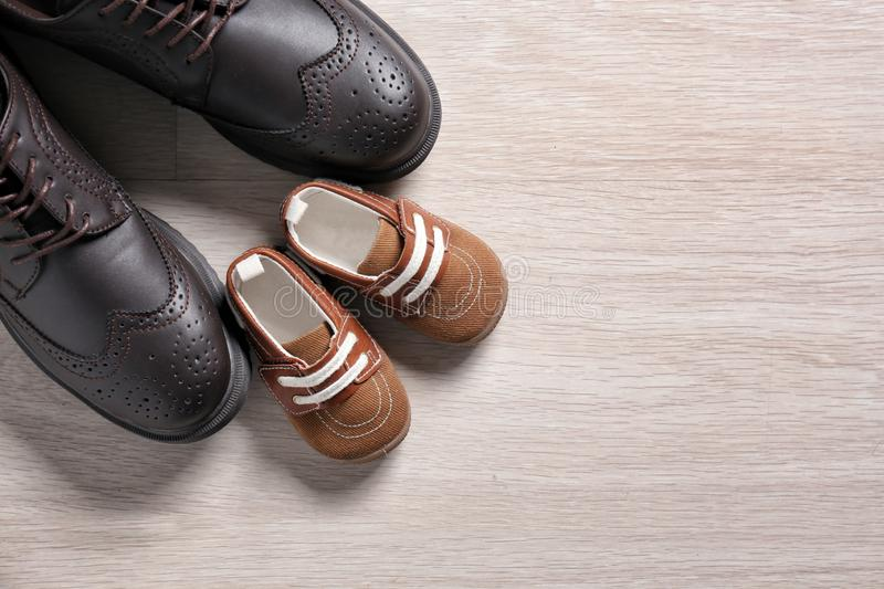 Big and small shoes on light background. Father's day stock image