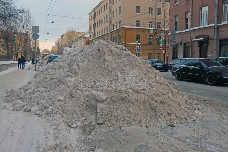 Big snowdrift on the side of the road stock photos