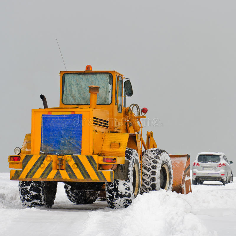 Download Big snowplow clearing road stock photo. Image of blizzard - 17472150