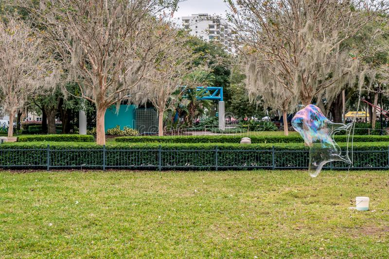 Big soap bubbles blowing at Eola Park, Downtown Orlando, Florida, United States. Big soap bubbles at Eola Park, Downtown Orlando, Florida, United States stock photography
