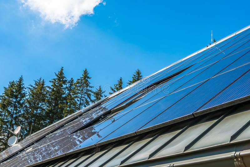 Big solar energy panel on the roof of a house. Blue sky on a background stock image