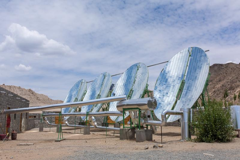 Big Solar Water Boilers in modern experimental school in Leh, Ladakh, India. Alternative energy conсept royalty free stock image