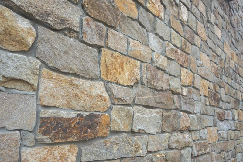 Big solid stone cement wall in a perspective angle stock image