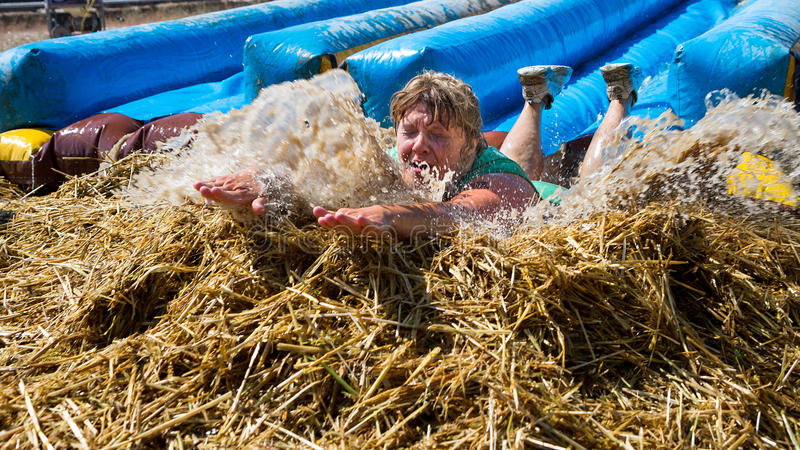Big Splash At The End Of The Slide Editorial Stock Image