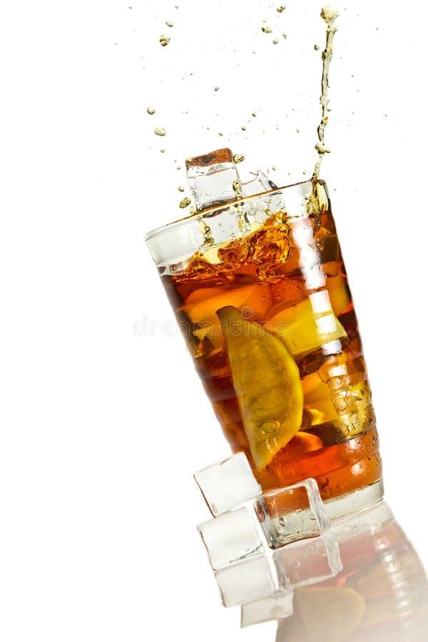 Big splash in ice lemon tea stock photography