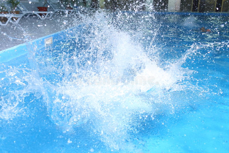 Big splash in pool stock images