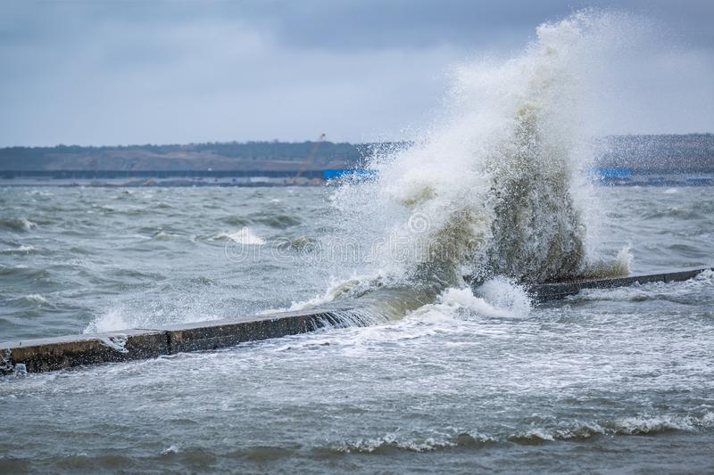 Big splash of wave on the flooded embankment of the resort city on the Black Sea royalty free stock photography