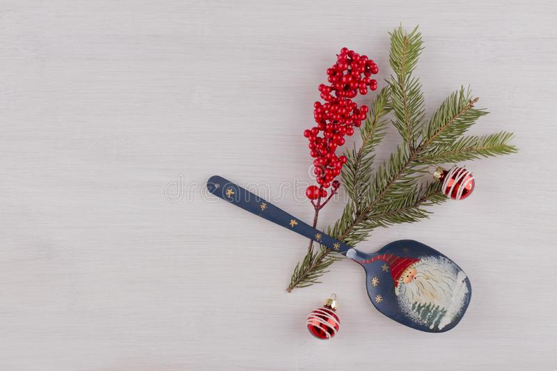 Big spoon with Santa Claus picture as part of christmas composition on a light background. royalty free stock images