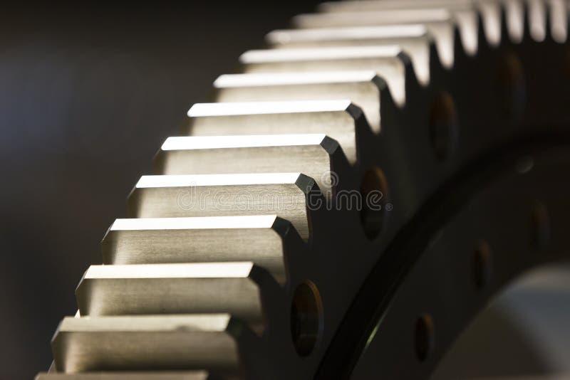 Big steel gear shot. Close-up photo royalty free stock photo