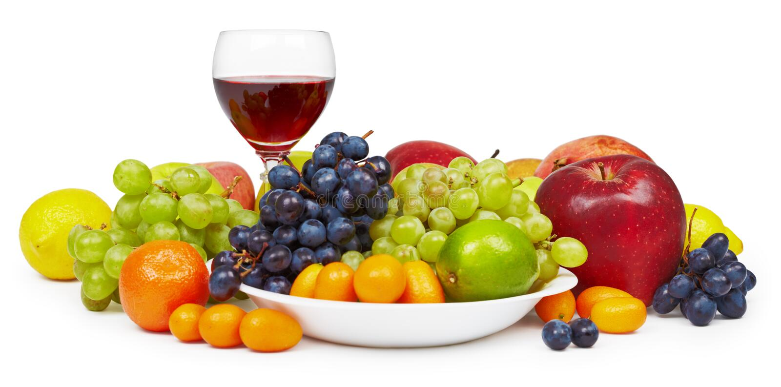 Big still-life with fruit and wine glass. The big still-life with fruit and a wine glass on a white background royalty free stock images