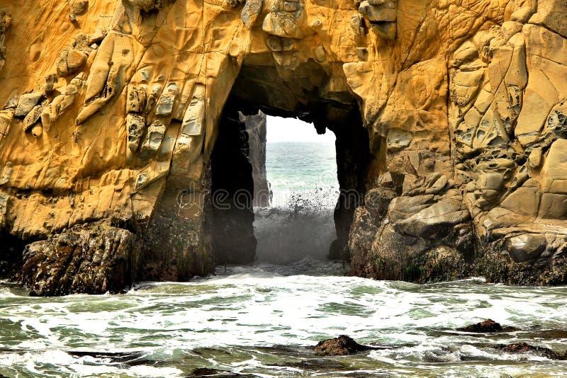 Big stone hole at pfeiffer beach stock photos