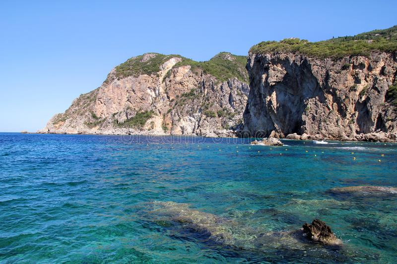 Big stone mountains and rocks coastline as islands in sea or ocean against clear sky landscape. Summer trip. Beautiful Greece. stock photo