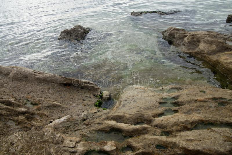 Big stone in the sea royalty free stock photos