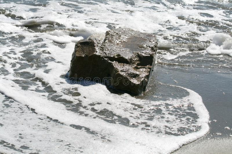 Big stone in the sea royalty free stock photography