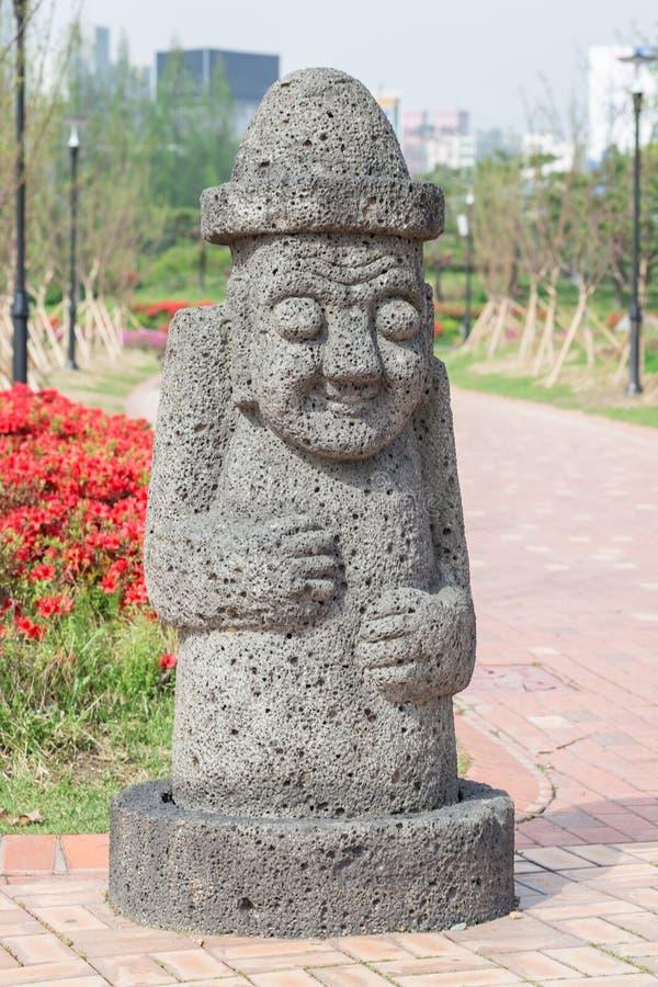 Big stone statue of hareubang Jeju island idol, shot in Yurim pa stock images