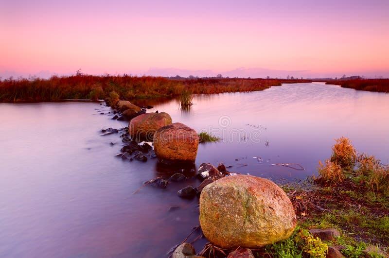 Big Stones On River At Sunrise Stock Photo