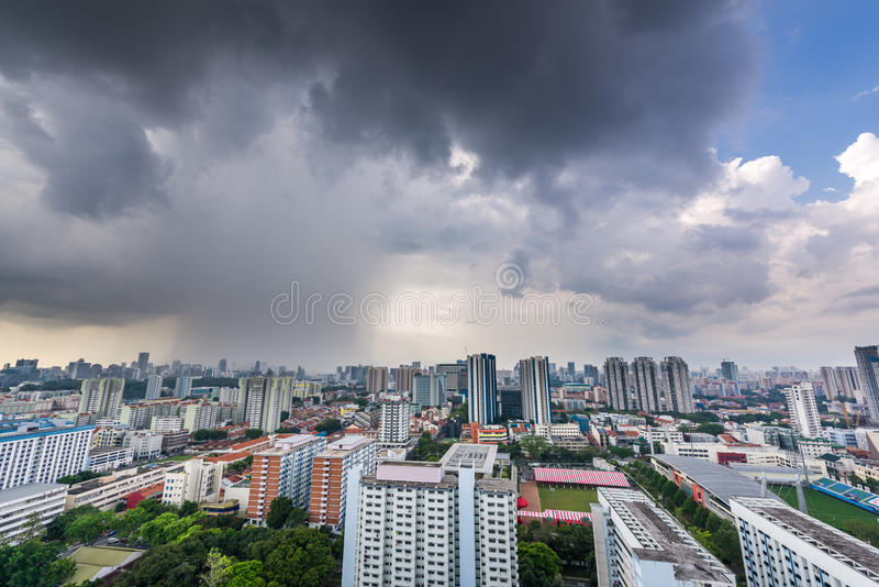 Big storm clouds forming over city stock photography