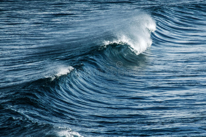 Big stormy ocean wave. Blue water background stock images