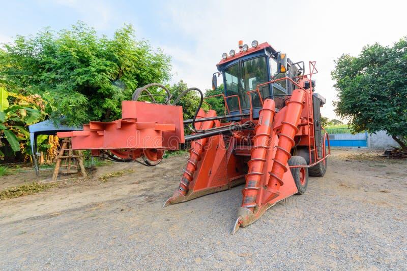 Big Sugarcane harvester. Big red Sugarcane harvester on ground stock photos