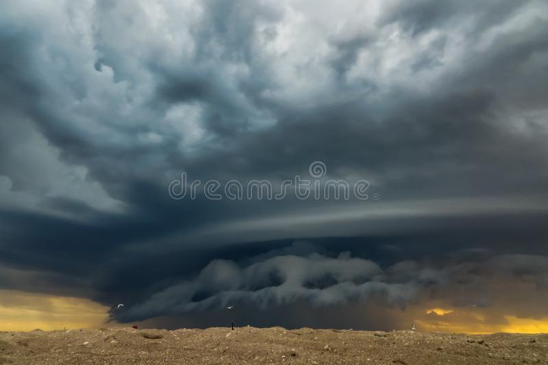 Summer storm at sunset on the beach royalty free stock image