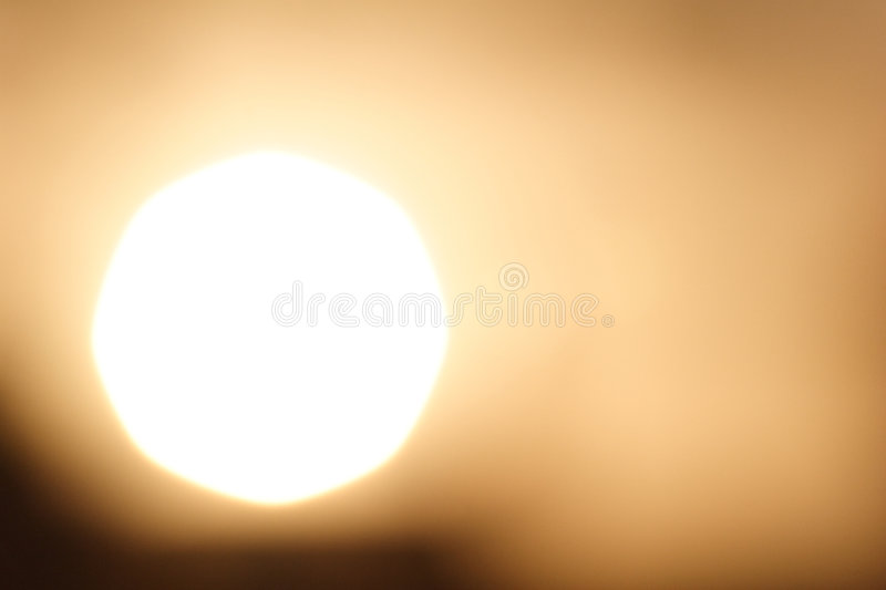 Big Sun. A large sun at sunset - an abstract image suitable for background use