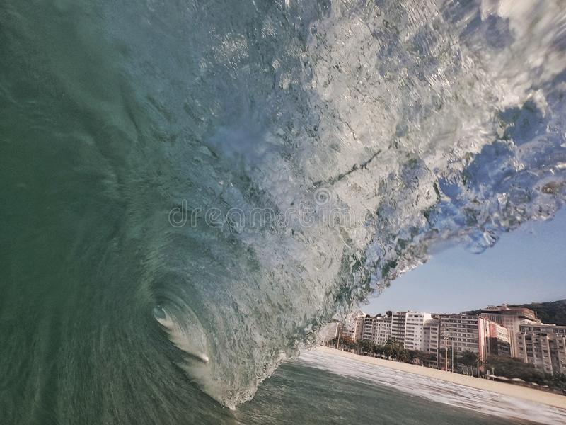 Big surf in Rio. Sunny winter day with a big wave in the shorebreak of Leme's beach,  Rio de Janeiro  - Brazil, lemes royalty free stock images