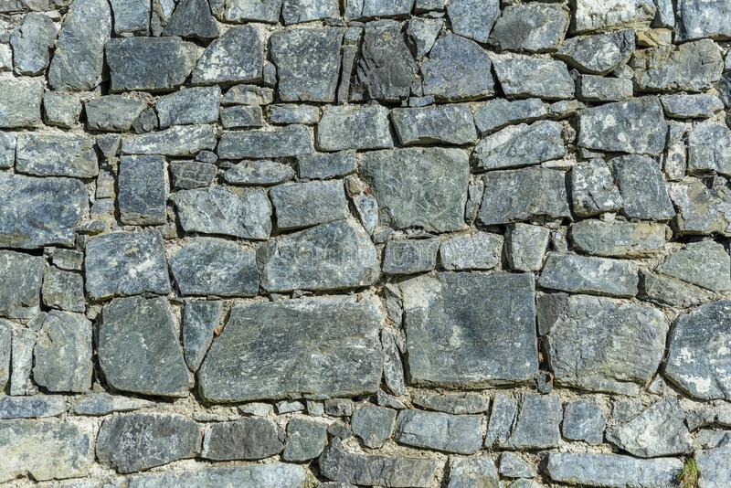 Big surface decorative uneven cracked real stone wall surface royalty free stock photos