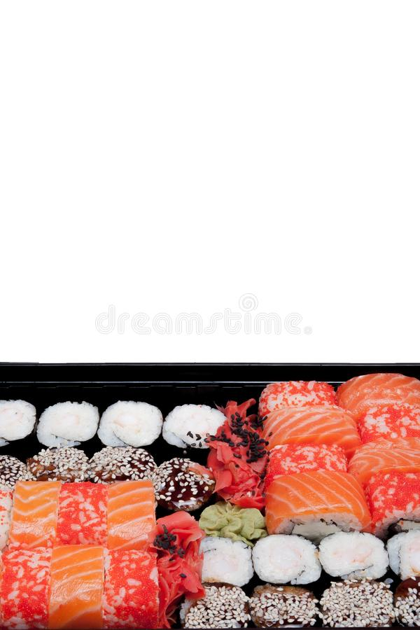 Big sushi set ib black plastic box on white background, top view close up, copy space stock photos