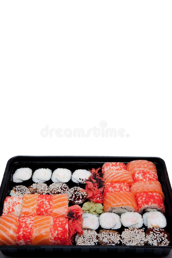 Big sushi set ib black plastic box on white background, top view close up, copy space royalty free stock photos